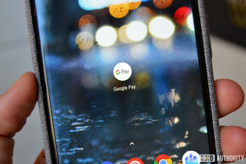 The Google Pay logo on a smartphone.